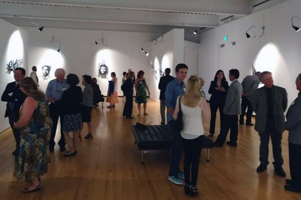 Guests mingling during a Gallery Show at The Hyde Art Museum
