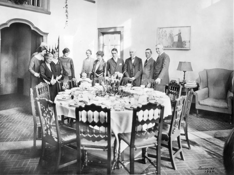 Historic photo of people standing in the dining area a The Hyde House